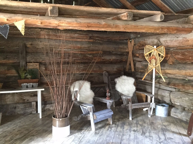 The barn is solid, bright and clean with furnishings to enhance the old world look. Photo by Janice Blain.