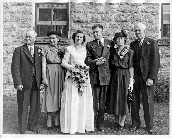 Boyd-McCullough wedding, Aug. 26, 1950. The wedding was at Stittsville United Church and the reception was at the home of the bride - the Boyd farm house. Left to right: Byron and Gertrude Boyd, parents of the bride; Maybelle Boyd (bride), Frank McCullough (groom, from Navan, Ontario); Annie and George McCullough (parents of groom  Photo courtesy of Melodie McCullough.