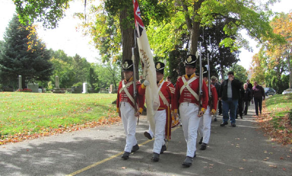 A colour party leads the procession towards the grave market. Photo by Karen Prytula.