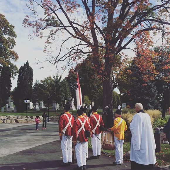 A colour party leads the procession towards the grave market. Photo by Laura Young.