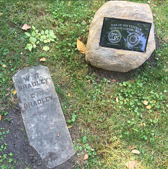 Footstone of Captain William Brown Bradley and his son Sands Bradley, and the new plaque. Photo by Laura Young
