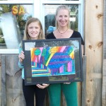PHOTO: Young Artist of the Month winner picks up prize