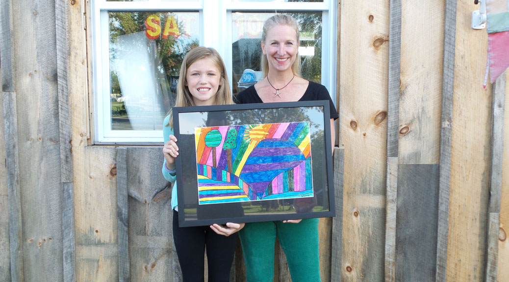 Brianna Richard with Amy Walker from Walkerworks Picture Framing.