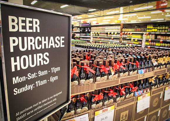 Beer display and sign showing hours for sale. Photo by Barry Gray