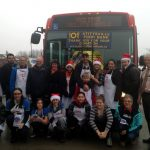 PHOTO: Filling a bus with food donations at Brown's Independent on Saturday
