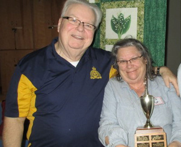 John Brummell with winner Judith Cox at the Stittsville Goulbourn Horticultural Society meeting on February 20.