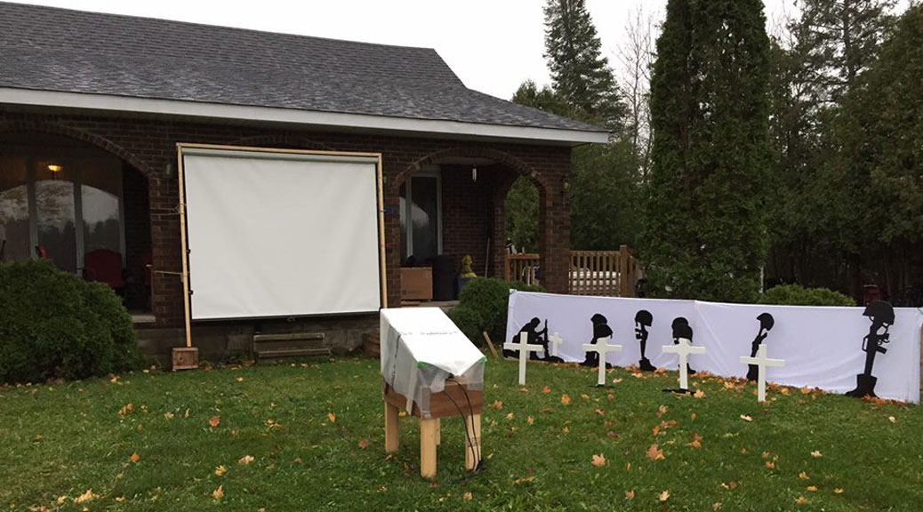 The projection screen and display outside of Dennis Burton's home south of Stittsville.