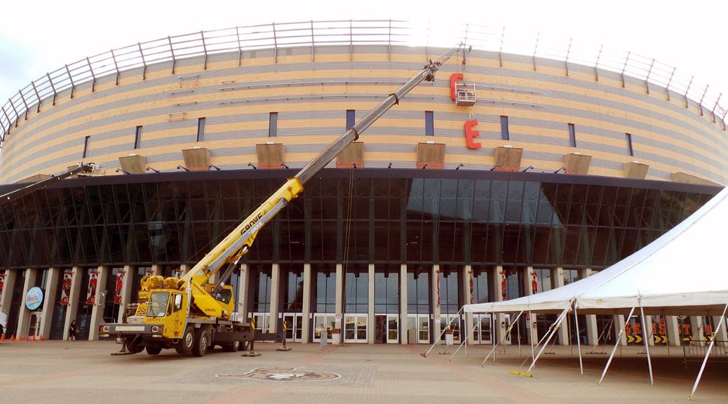 Installing the new Canadian Tire Centre sign in August 2013.