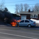 Firefighters extinguish car fire on Shea Road