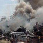 Major fire at vehicle scrap yard on Flewellyn Road