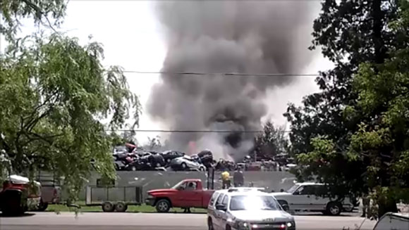 Smoke billows from the Cash For Trash salvage yard on July 8, 2015. (Footage courtesy of Joan McCagg)