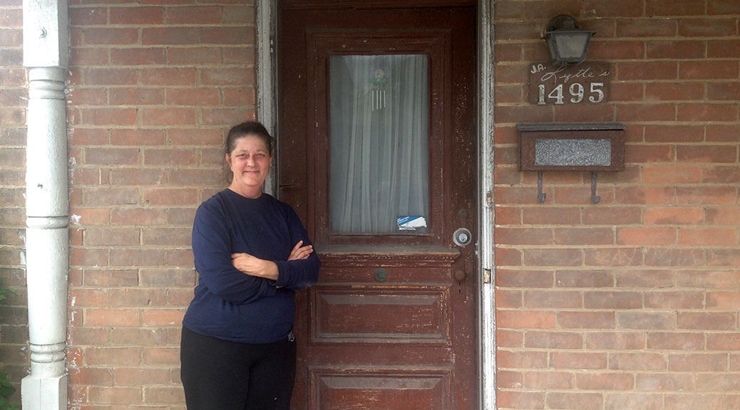 Cathy Lytle stands in front of her family's home at 1495 Stittsville Main Street.