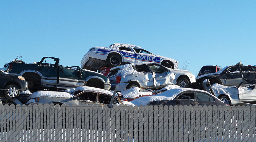 Cherry on top: Police car on top of a trash heap at the Cash for Trash junkyard on Flewellyn Road.
