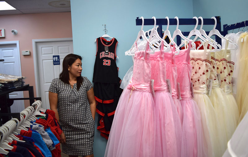 Jhoanna Prinzo with some of the shop's gowns. Photo by Devyn Barrie