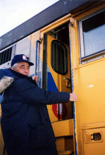 Lorne Blackburn climbs aboard Via Rail engine 6409 on January 14, 1990. Photo courtesy of the Goulbourn Museum.