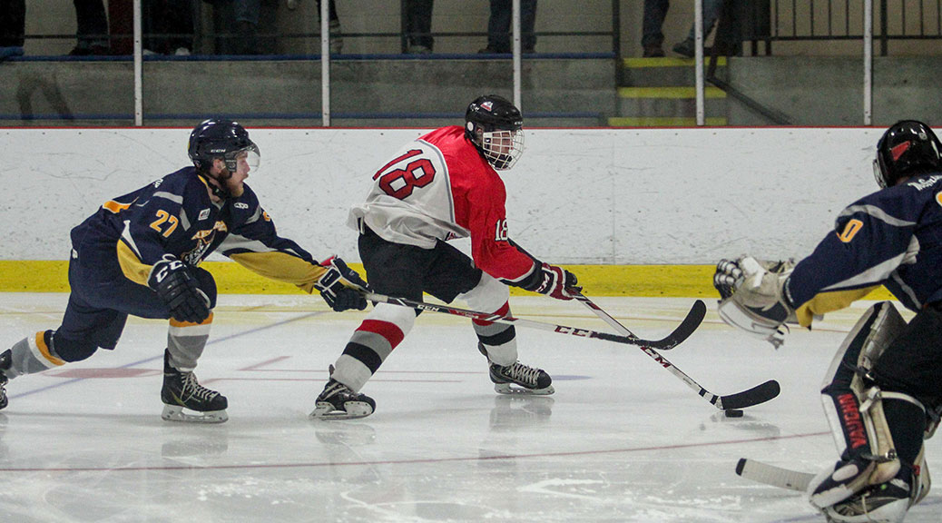 Rams player Cole Carter slips past Renfrew's Blair Barr. The Rams won game four 6-3 and the series over the Renfrew Timberwolves in four straight games clinching the Eastern Ontario Junior Hockey League Valley Division. Photo by Barry Gray.