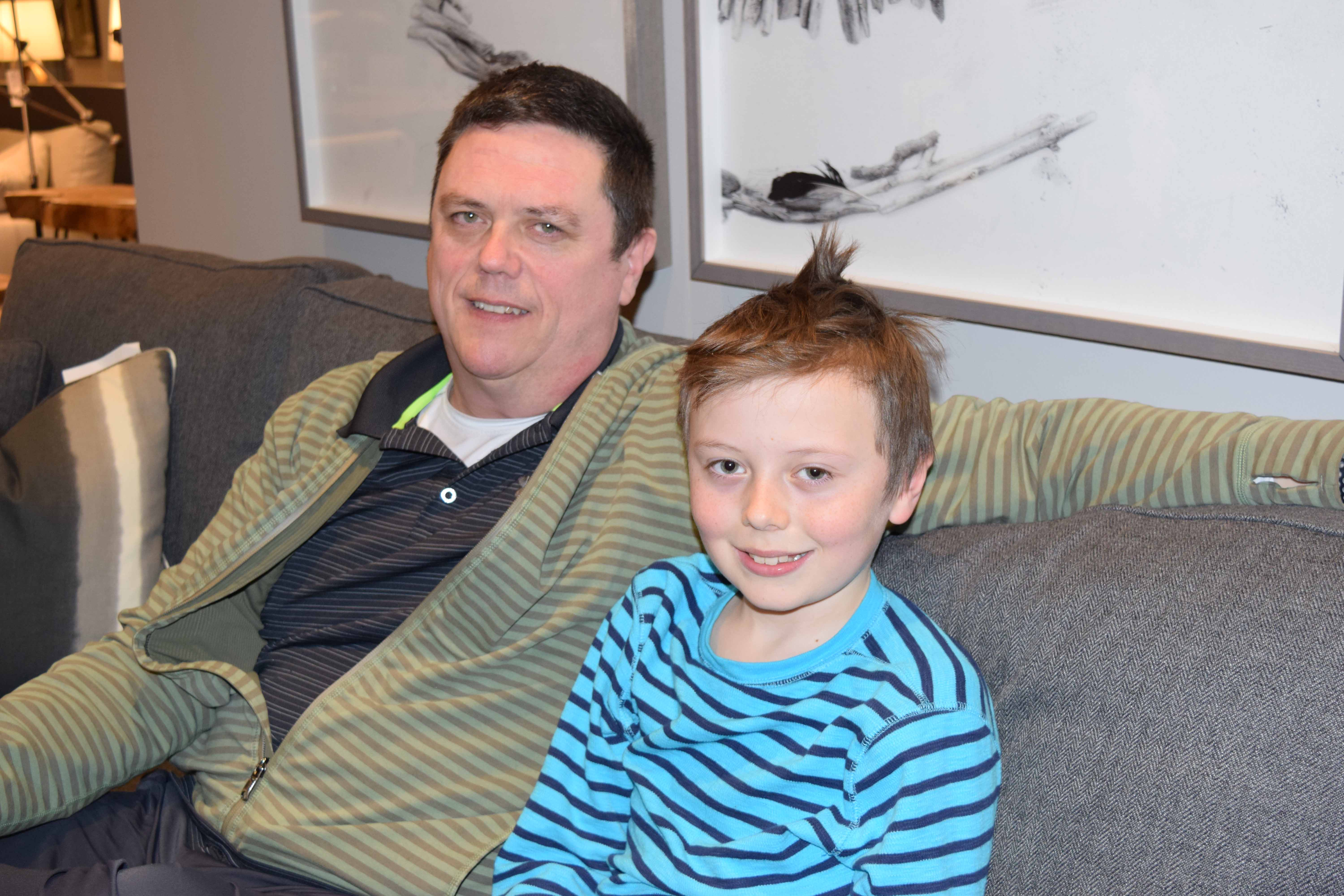 Sean O'Leary with his son, Ronan, inside the family store MYHome Furniture in Kanata. O'Leary says he is trying to give his children as normal a life as possible as his daughter struggles with drug addiction. (Devyn Barrie/OttawaStart.com)