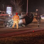 PHOTOS: Car flips over on Hazeldean Road near Farm Boy