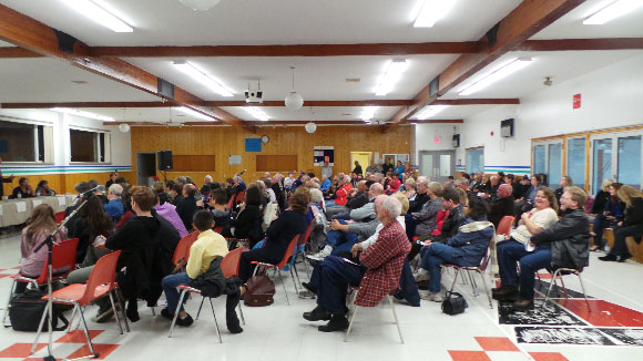 About 150 people were at Johnny Leroux Arena for the debate.
