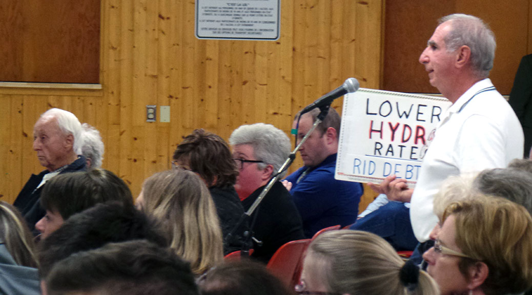 "Stittsville debate. Guy with ""Lower Hydro Rates"" sign."