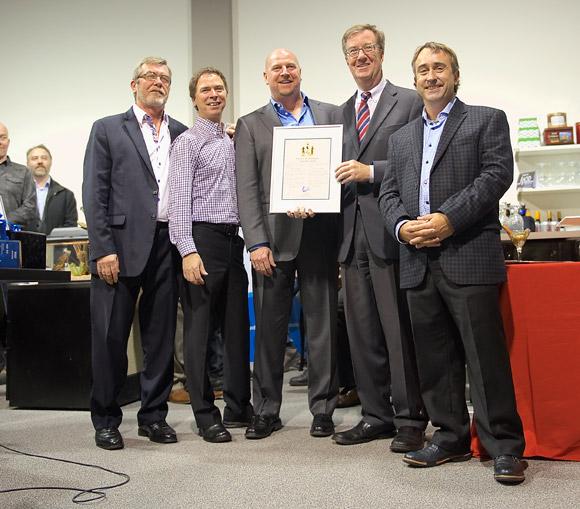 Mayor Watson helps celebrate with Decisive Technologies on December 18, 2014.
