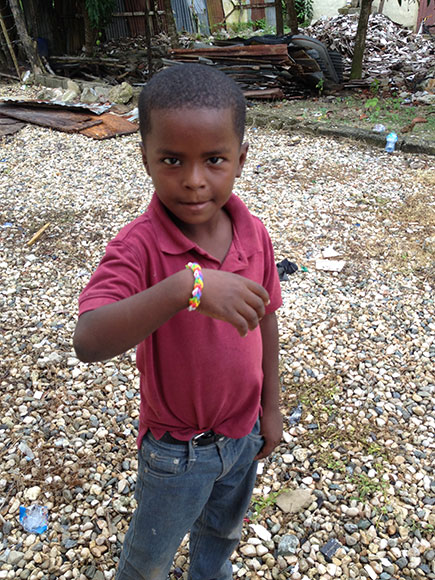 A young boy with a rain balloon bracelet, donated by students at Stittsvile Public School. Photo courtesy of Shannon Helleman.