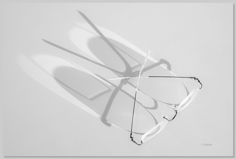 Eyeglasses and Shadow. Photography by John Edkins.