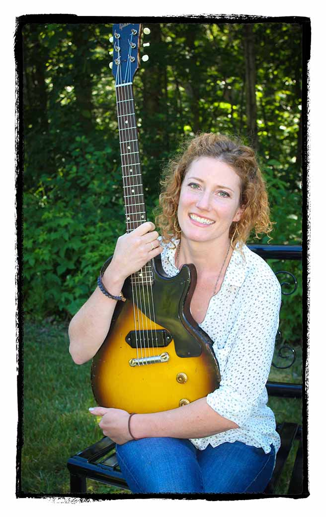 Kathleen Edwards reunited with her Gibson guitar. Photo by Barry Gray.