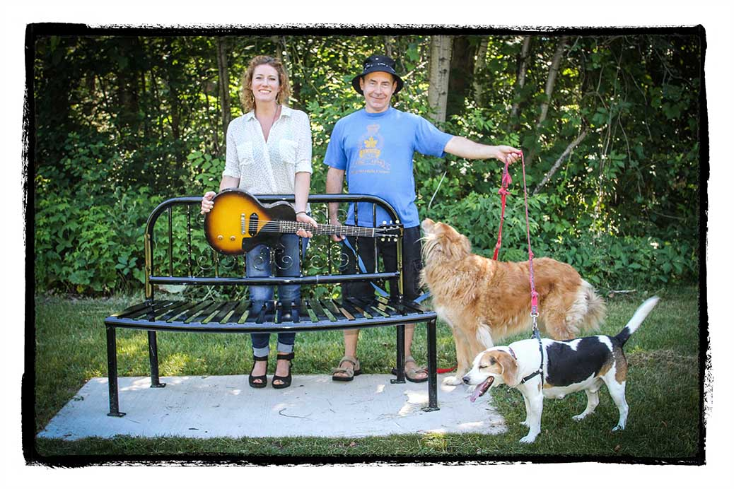 Kathleen Edwards with Russell Mason and his dogs Riggin and Beans ... along with Kathleen's guitar. Mason found the guitar while walking his dogs in Bell Park. Barry Gray (StittsvilleCentral.ca)