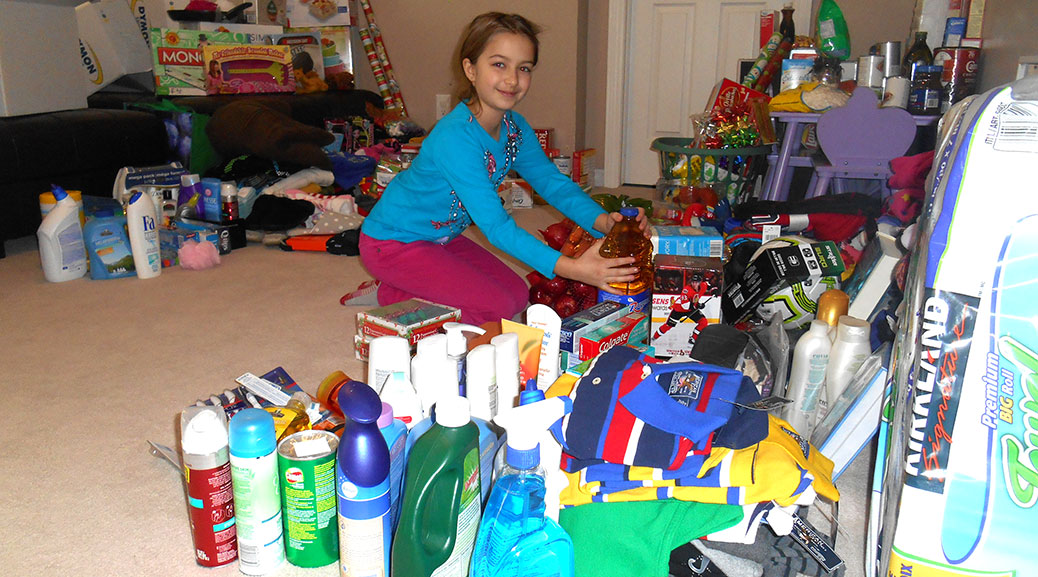 Stittsville Public School student Ella S. helps sort some of the many donations received.