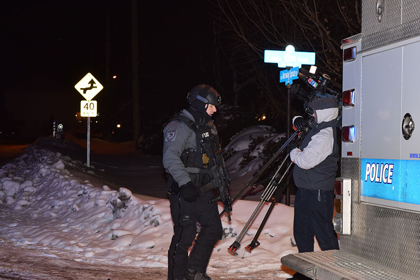 A CTV cameraman on scene with a member of the police tactical squad. Photo by Devyn Barrie.