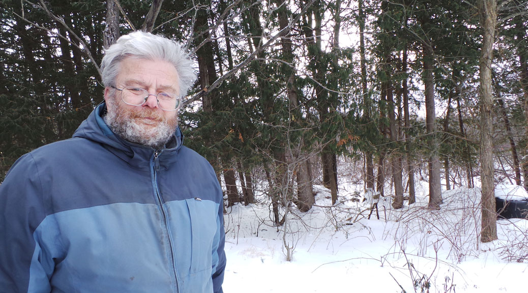 Gerry Kroll stands in front of a large grove of trees that are slated for removal beginning this week.