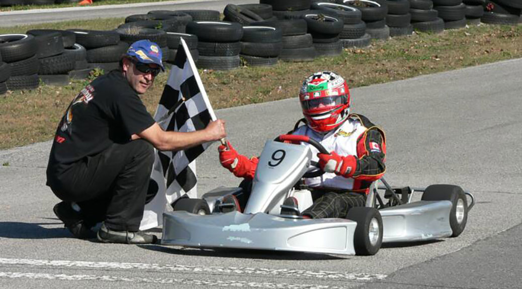 Enrico Valente crosses the finish line at a recent kart racing event.