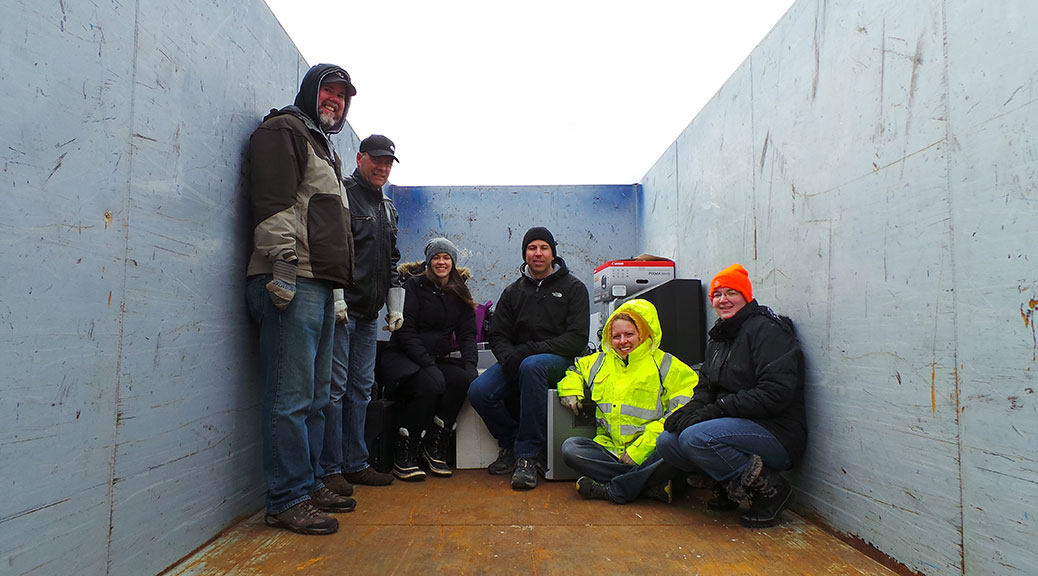 Some very chilly parent volunteers collected e-waste on Saturday morning, as a fundraiser for Stittsville Public School. Photo by Glen Gower.