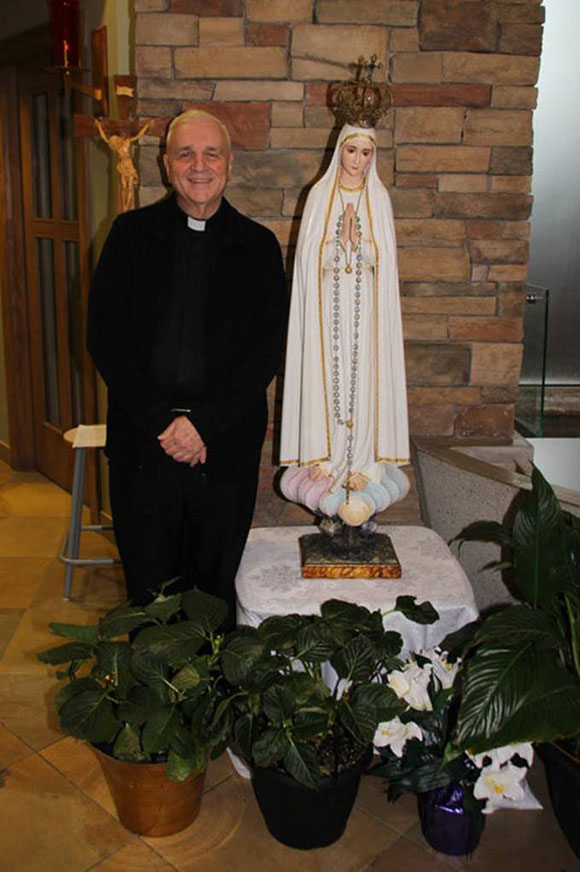 The statue on a visit with Monsignor Muldoon, Holy Spirit Parish, Stittsville May 2017.