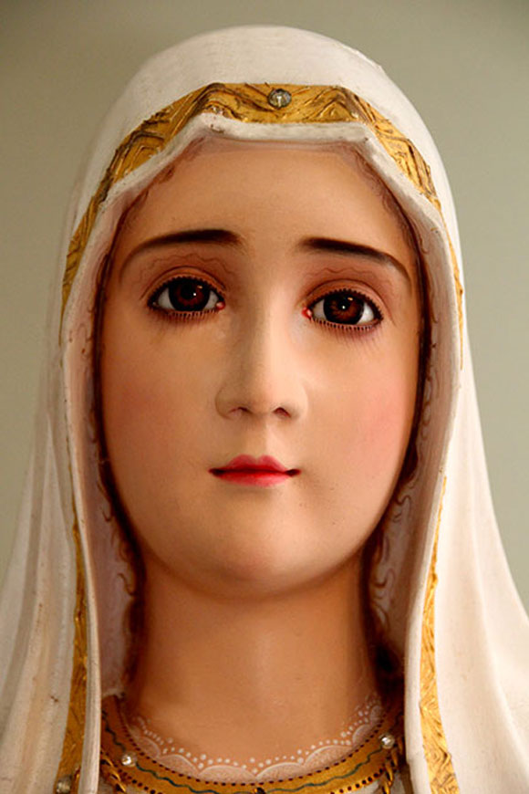 Closeup of the Statue (a woodcarving) without the crown. The statue was blessed in Fatima, Portugal on May 13th, 1982 by Pope John Paul II, on his thanksgiving trip to Fatima to thank Our Lady for sparing his life when he was shot the previous year.