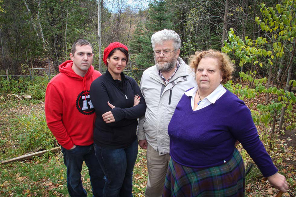 Ian McKim, Jillian McKim, Gerry Kroll and Keldine FitzGerald stand in front of a proposed 140 housing development on marshlands off Fernbank Road. Photo by Barry Gray.