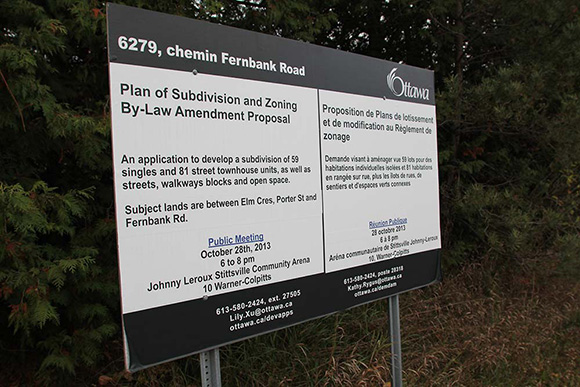 City of Ottawa sign indicating the meeting for a proposed 140 housing development off Fernbank Road.  Photo by Barry Gray.