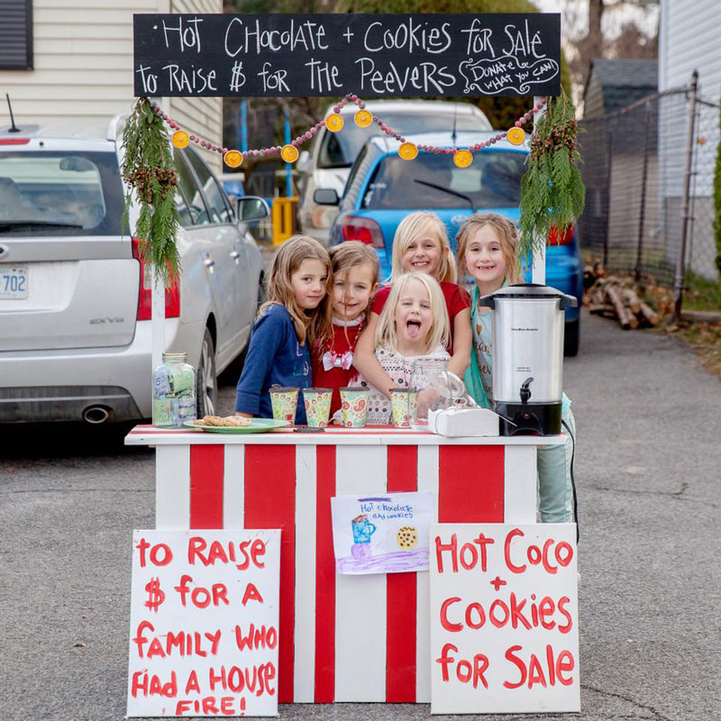 Five kids in Fringewood - Priscilla, Ellie, Ashlynn, Rosalyn, and Leah - spent the day outside today selling hot chocolate and cookies to raise money for their neighbours, the Peever family, who lost their house to a fire in November. The group raised $900.50 thanks to the generous support of the community. Photo by Lee-Anne Haggett.