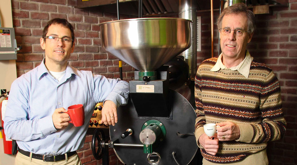 Paul Melsness and Paul Jay in front of the roaster at Gaia Java