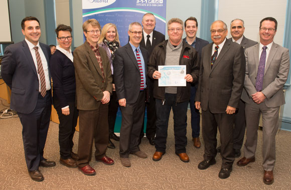 Stittsville resident Gerry Gray surrounded by city councillors and staff. Photo via Shad Qadri's office.