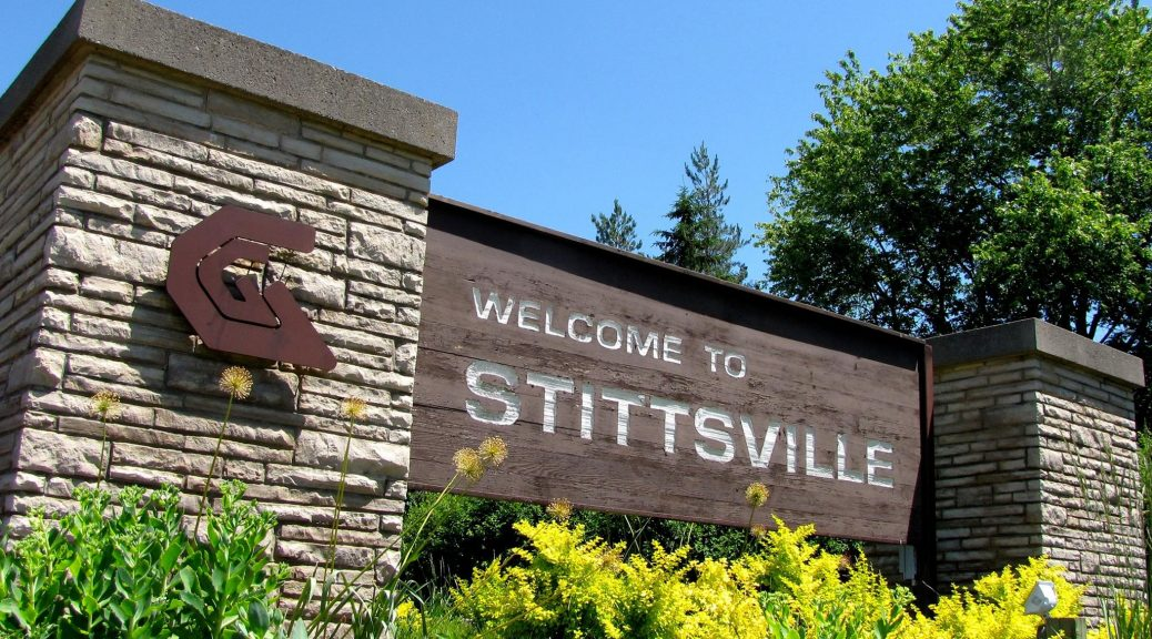 "The ""old"" Welcome to Stittsville sign, including the former Goulbourn municipality ""G"" logo."