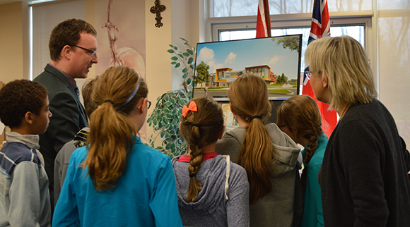Students check out an artist rendition of the new french Catholic high school in the Fernbank area. Photo supplied by the CECCE.