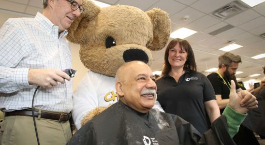 Congrats to Helene Hutchings for organizing another successful Hair Donation Ottawa event today to support cancer research. With donations still coming in, the event will raise at least $90,000. Hutchings is pictured above with the CHEO Bear, watching as Ottawa Mayor Jim Watson shaves Stittsville councillor Shad Qadri's head. Photo by Barry Gray.