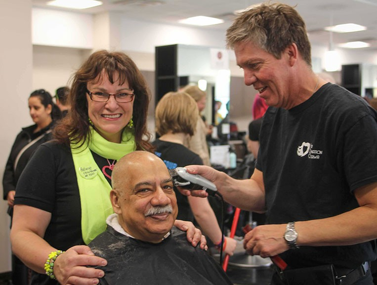 City councillor Shad Qadri had his head shaved as part of Sunday's fundraising event at Algonquin College. Wayne Patrick from Shears in Stittsville has the razor in hand. Photo by Barry Gray.