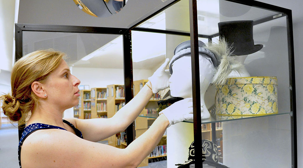 Tracey Donaldson puts the finishing touches on the display case. Photo via the Goulbourn Museum.