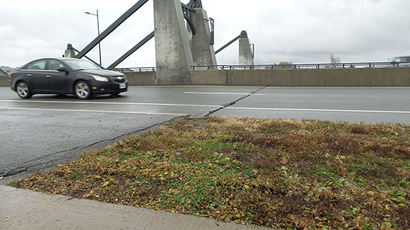 November 2015. A large crack across the western edge of the westbound lane. The crack continued across to the other side of the bridge, and there was a similar break on the east side as well.