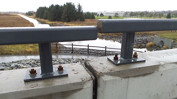 The north side bridge railing, where the west approach meets the main bridge deck. This photo was taken in November 2015.