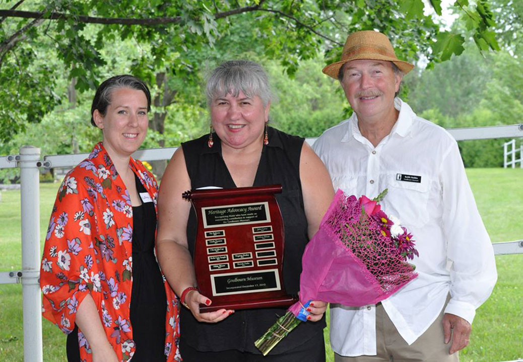 Hélène Rivest, centre, with Goulbourn Museum's Curator Manager, Kathryn Jamieson, and Chairperson Keith Hobbs. Photo via Goulbourn Museum