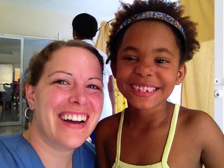 Shannon Helleman with one of the patients her team helped in the Dominican Republic.